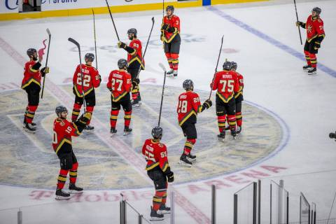 Golden Knights players celebrate with the crowd a 7-4 win over the Arizona Coyotes after the th ...