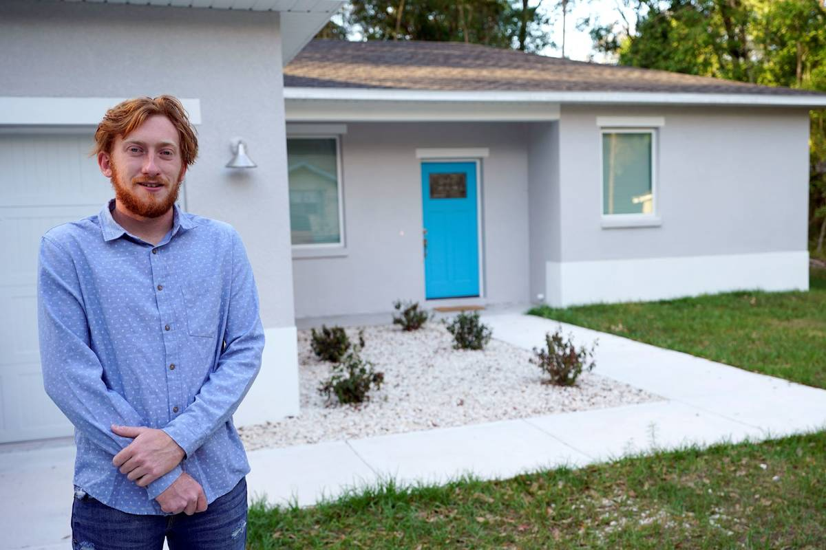 First-time buyer Kevin Muglach stands in front of his new home, Tuesday, April 6, 2021, in Oran ...
