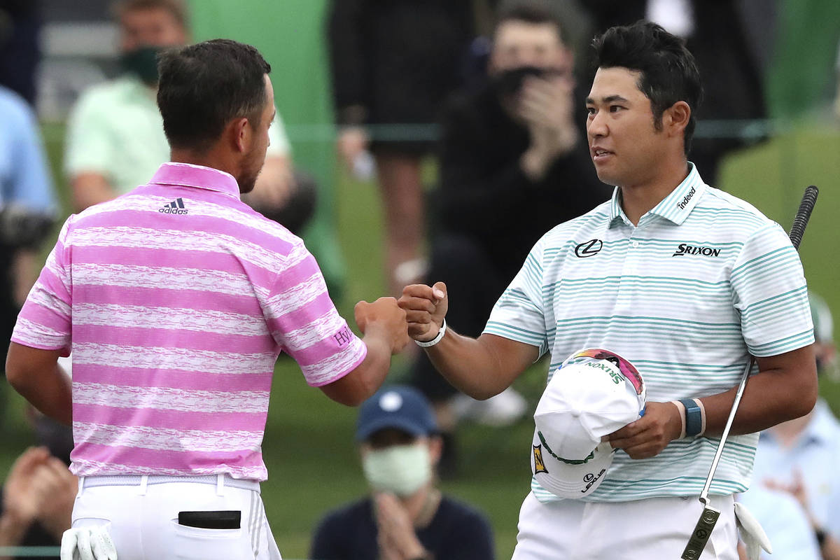 Hideki Matsuyama, right, and Xander Schauffele give each other a fist-bump on the 18th green as ...