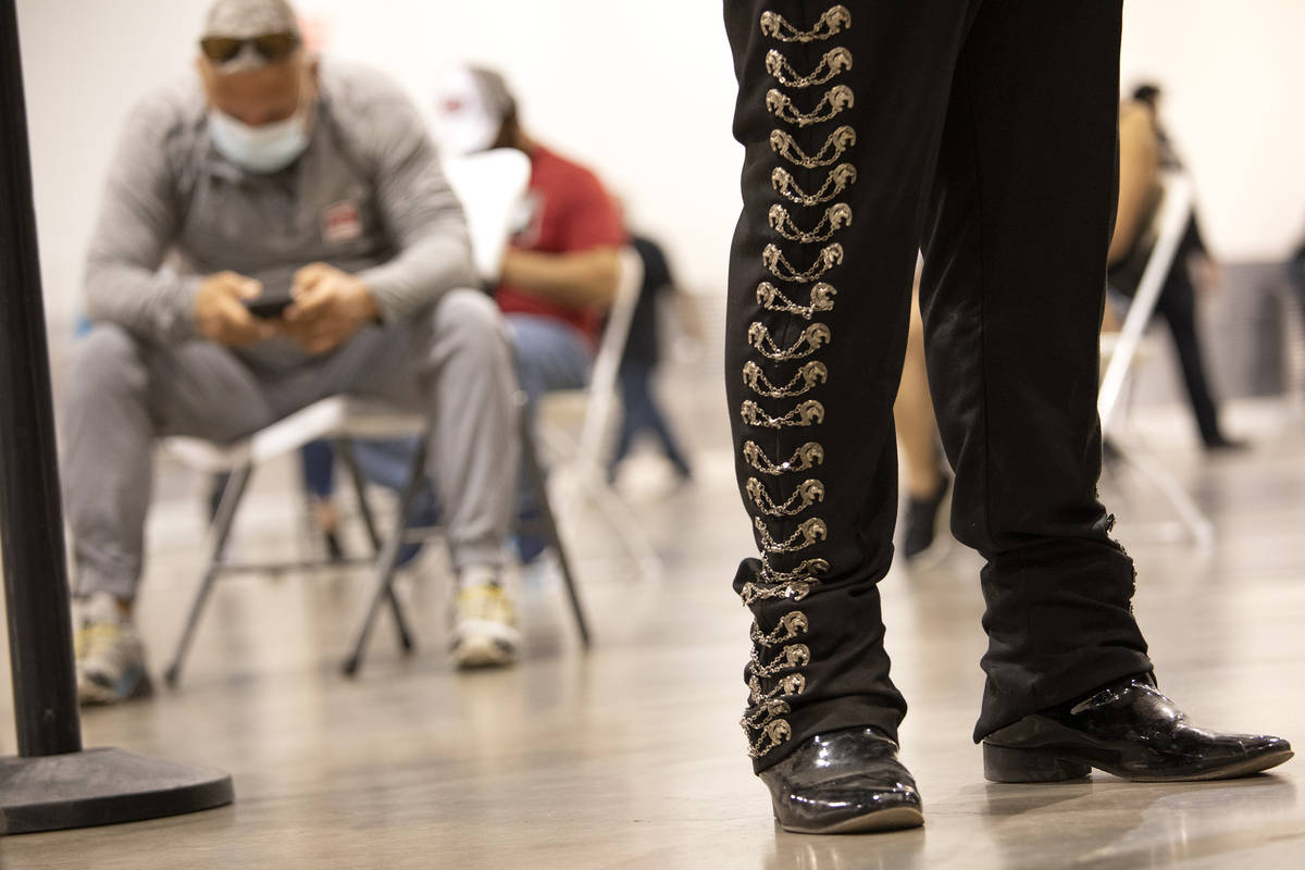 Mariachi Nuestras Raices performs while people wait for 15 minutes after getting the COVID-19 v ...