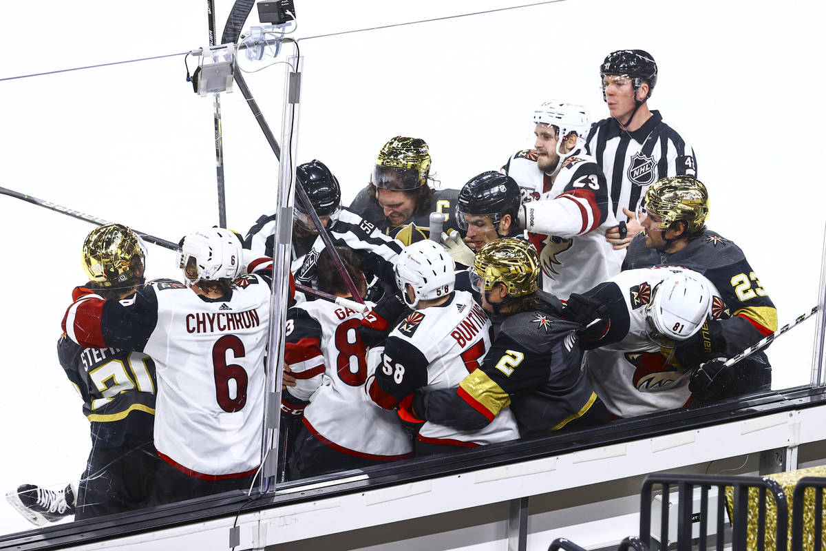 The Golden Knights get into an altercation with the Arizona Coyotes during the third period of ...