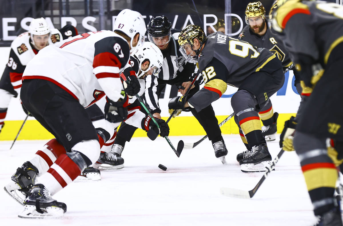 Golden Knights' Tomas Nosek (92) and Arizona Coyotes' Derick Brassard (16) fight for the puck d ...
