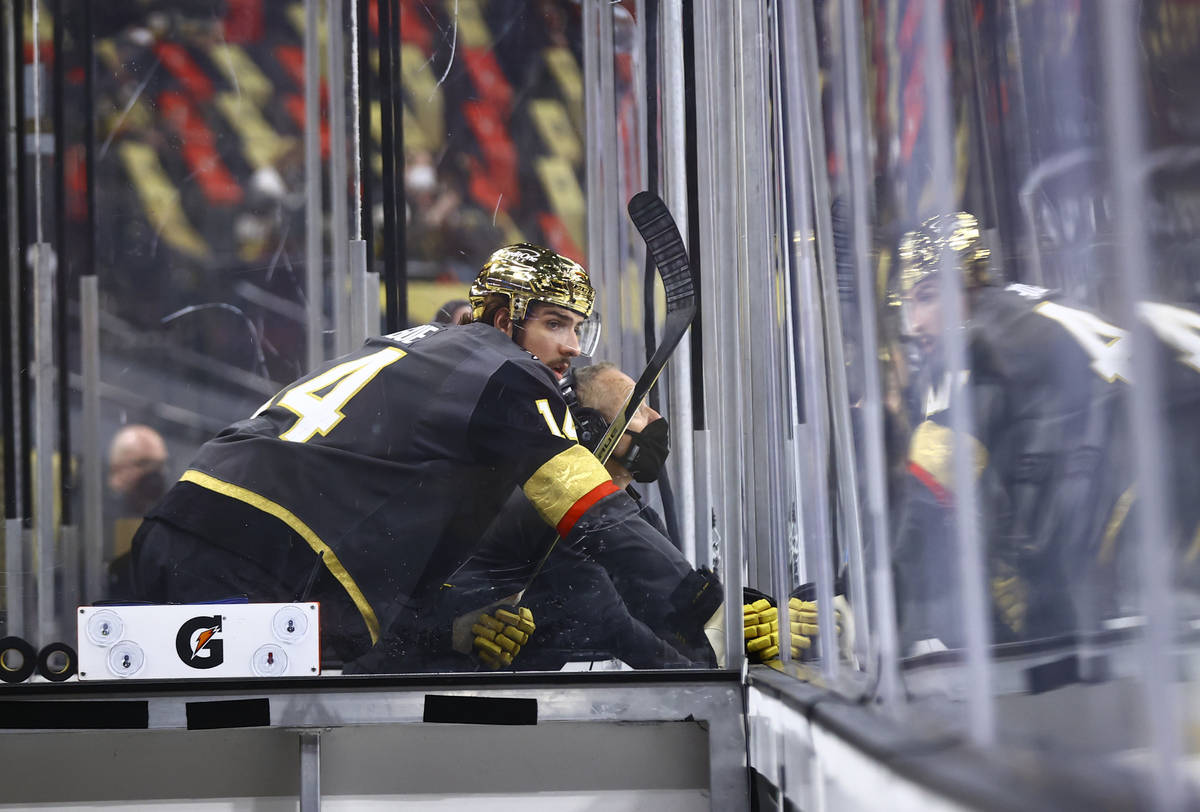 Golden Knights' Nicolas Hague (14) watches the action from the penalty box during the first per ...