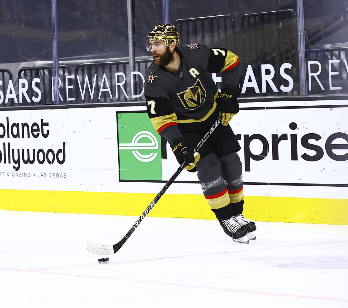 Golden Knights' Alex Pietrangelo (7) skates with the puck during the first period of an NHL hoc ...