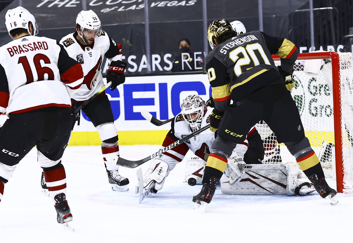 Arizona Coyotes goaltender Adin Hill (31) reaches out to stop the puck in front of Golden Knigh ...
