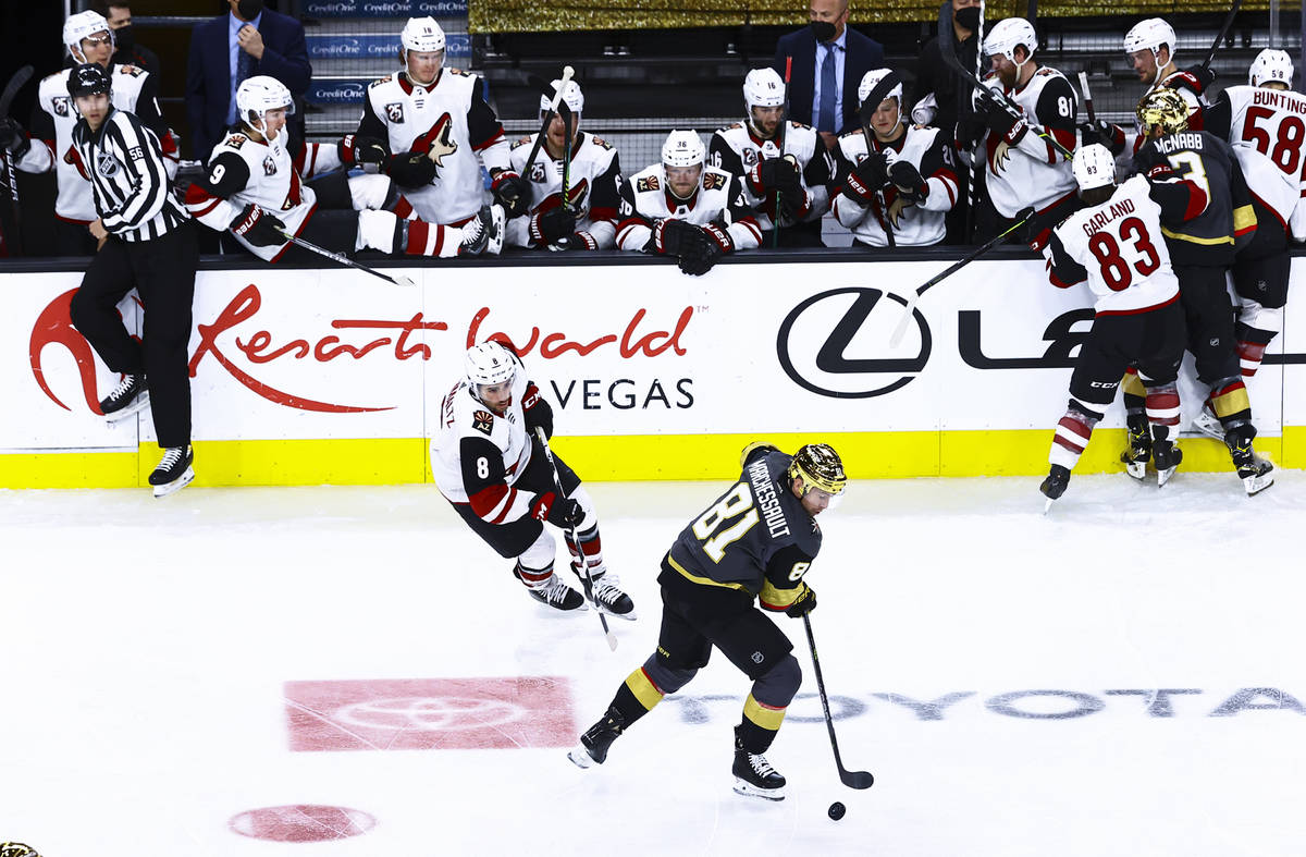 Golden Knights' Jonathan Marchessault (81) skates with the puck in front of Arizona Coyotes' Ni ...