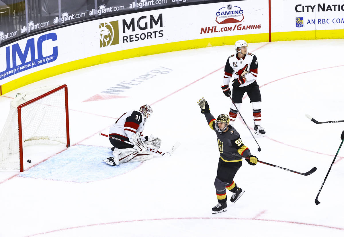 Golden Knights' Tomas Nosek (92) celebrates after scoring against Arizona Coyotes goaltender Ad ...