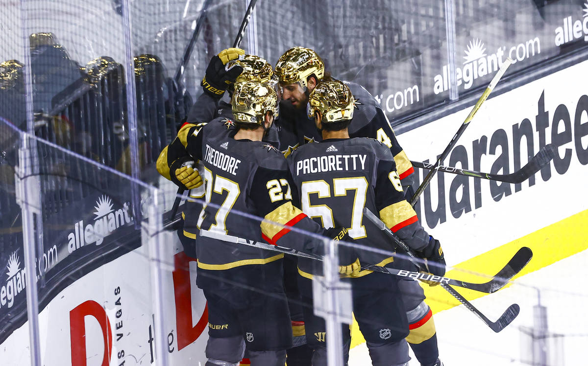 Golden Knights' Tomas Nosek celebrates with teammates after scoring against the Arizona Coyotes ...