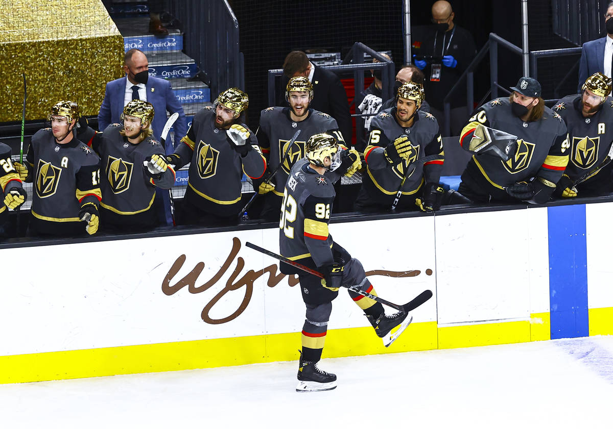 Golden Knights' Tomas Nosek (92) celebrates with teammates after scoring against the Arizona Co ...