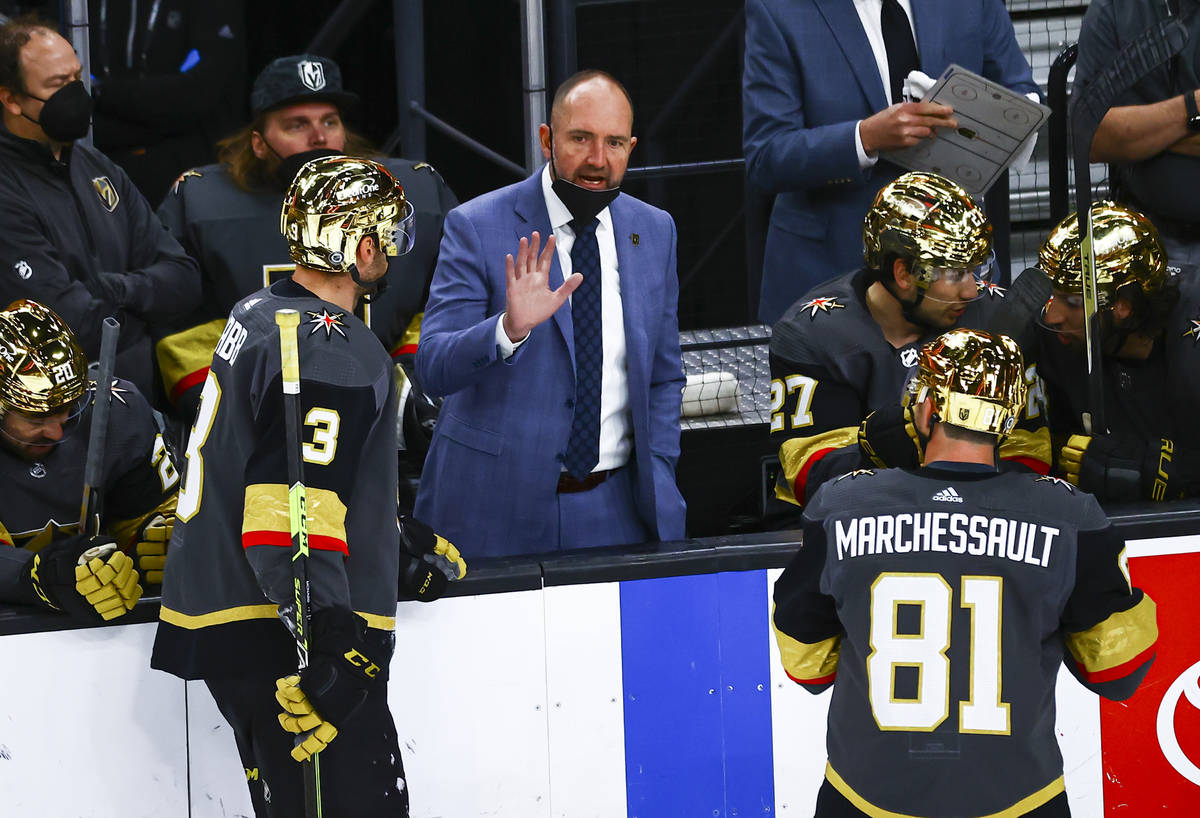 Golden Knights head coach Pete DeBoer talks with his team during the third period of an NHL hoc ...