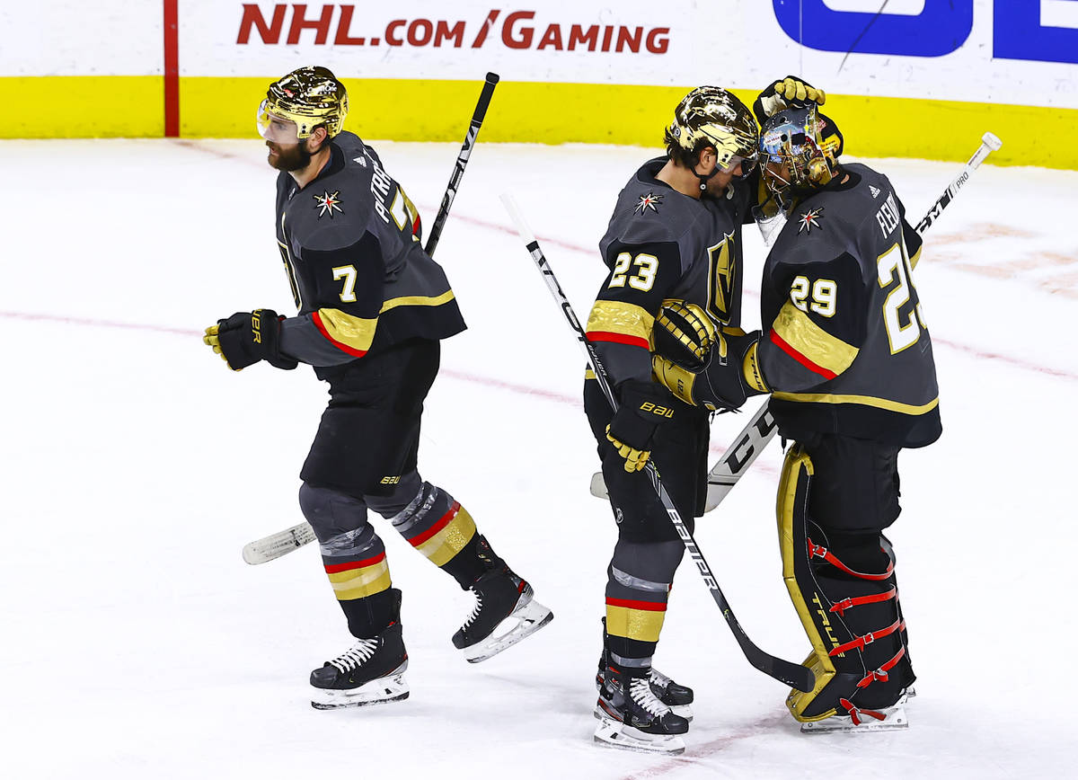 Golden Knights' Alec Martinez (23) celebrates with goaltender Marc-Andre Fleury (29) after a sh ...