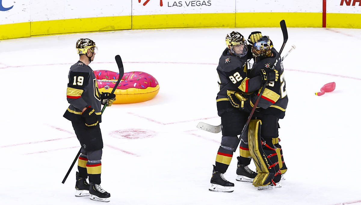 Golden Knights' Tomas Nosek (92) celebrates with goaltender Marc-Andre Fleury (29) after a shu ...