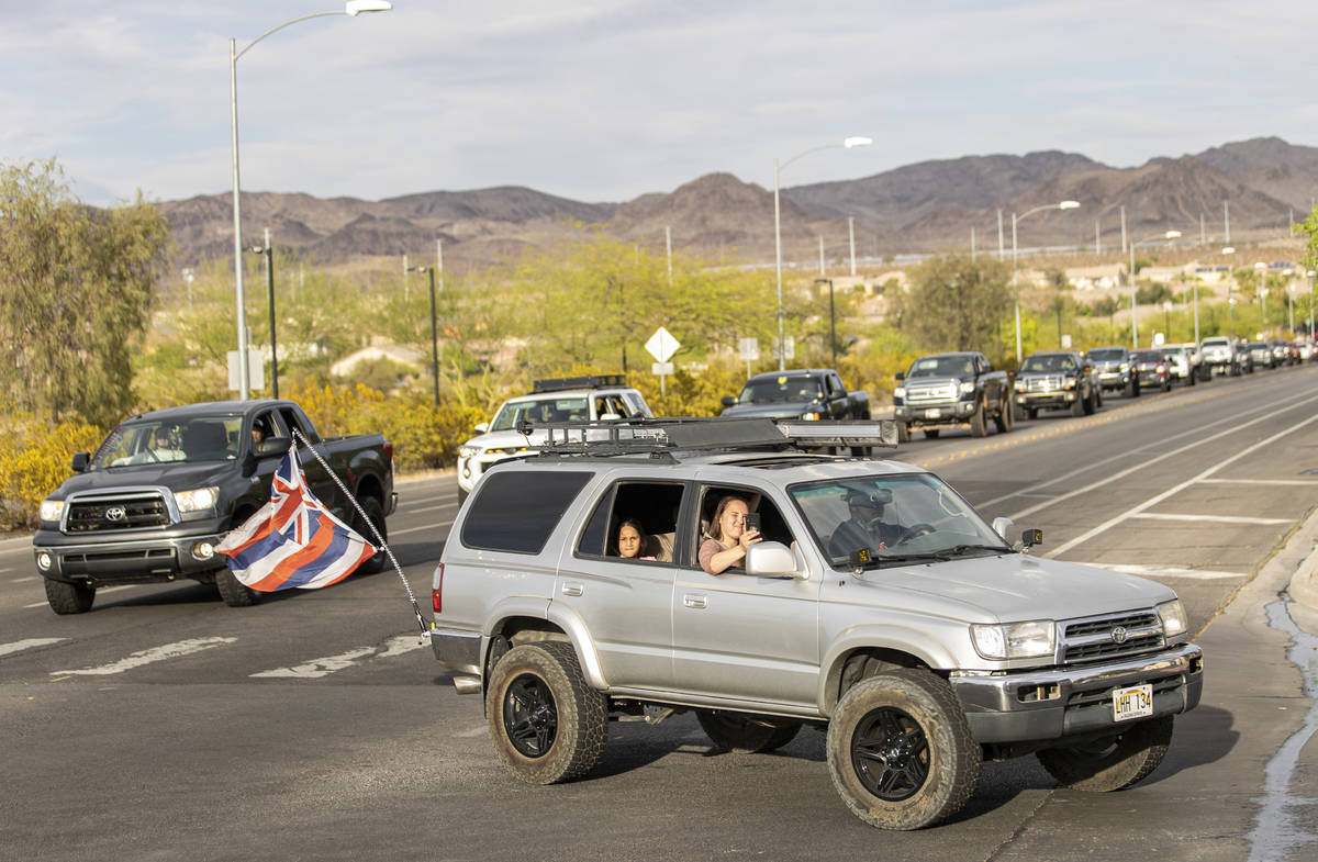Hundreds of trucks pack Newport Drive in Henderson during a vehicle parade hosted by Sin City T ...