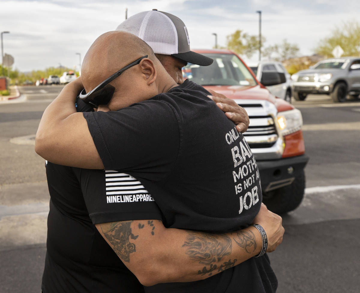 Richard Velasquez, left, father of Aaliyah Velasquez, gets a hug from a Sin City Tundras member ...