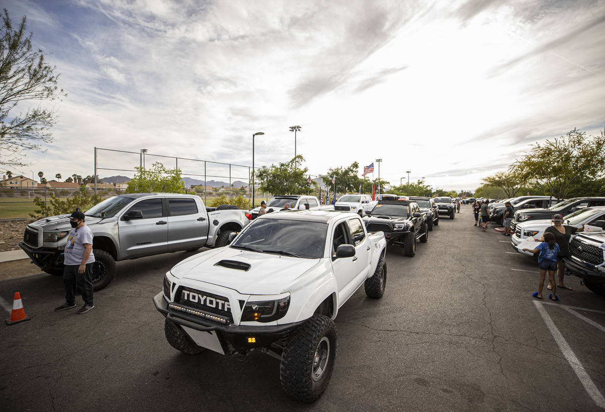 Members of Sin City Tundras wait to start a vehicle parade to support 9-year-old Aaliyah Velasq ...