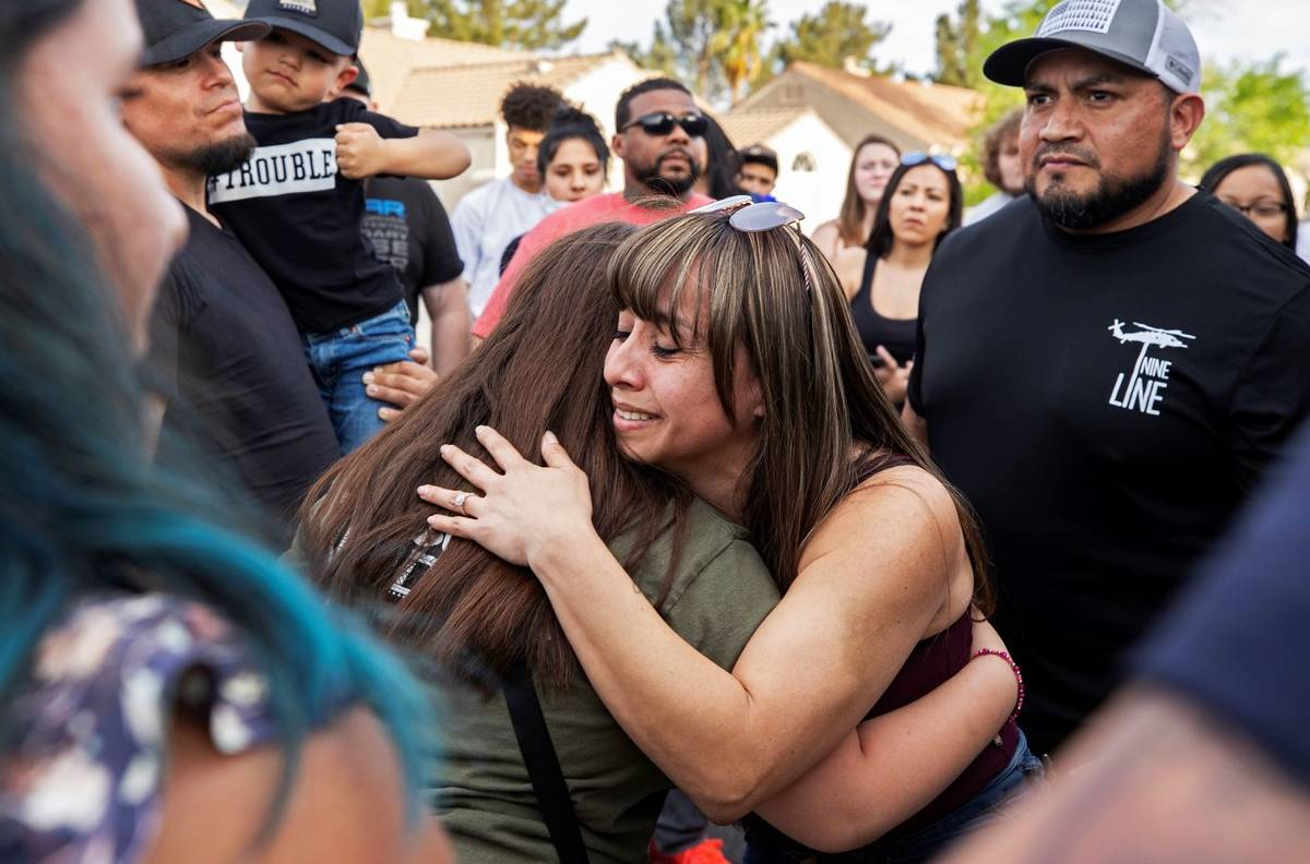 Carmen Velasquez, middle/facing, mother of Aaliyah Velasquez, 9, gets a hug from a friend durin ...