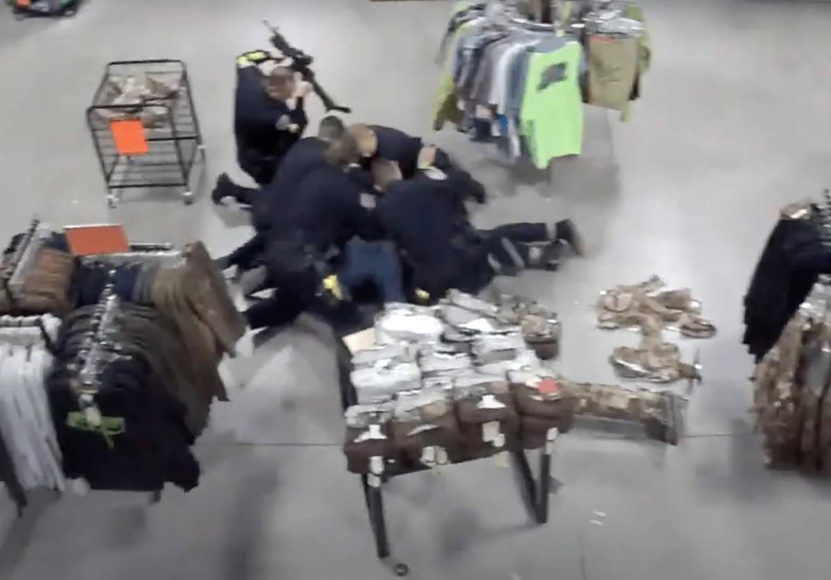 Screenshot from Sportsman's Warehouse surveillance video of Henderson Sgt. Michael Gillis, who ...