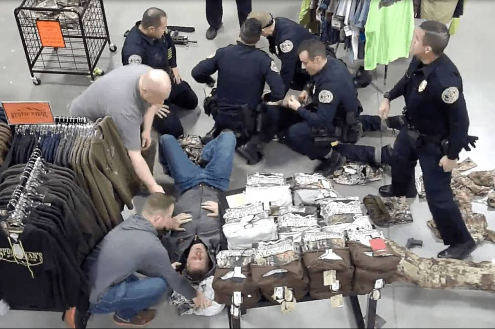 A screenshot from Sportsman's Warehouse surveillance video shows Herndon on the ground being ...