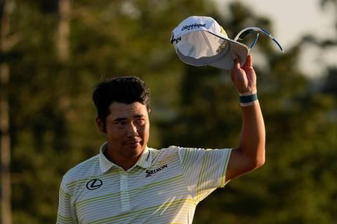 Hideki Matsuyama, of Japan, waves after winning the Masters golf tournament on Sunday, April 11 ...