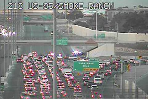 U.S. Highway 95 northbound lanes were closed at Lake Mead Boulevard before 6 a.m. Monday, April ...