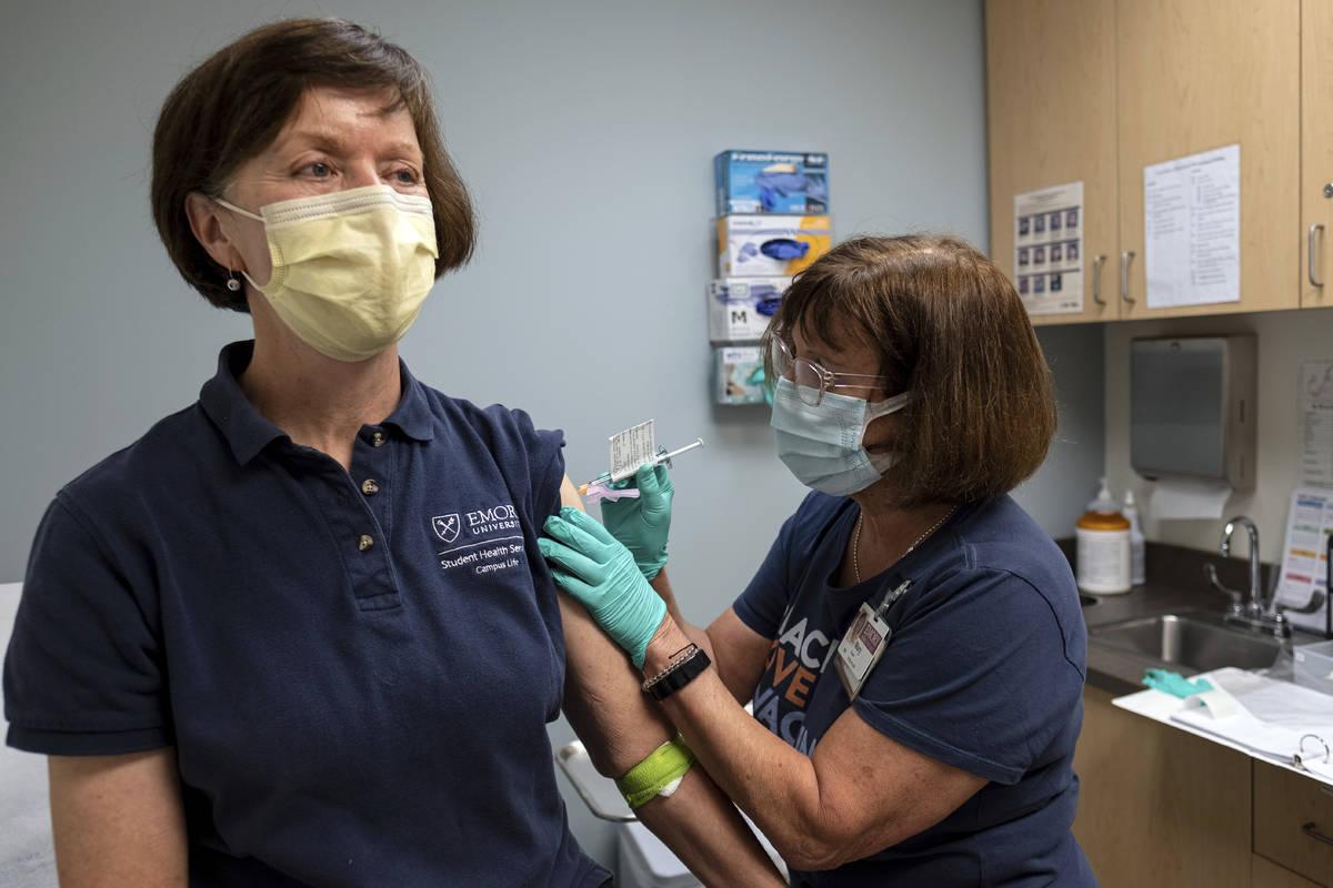Carol Kelly, left, receives a Moderna variant vaccine shot from registered nurse Mary Bower at ...
