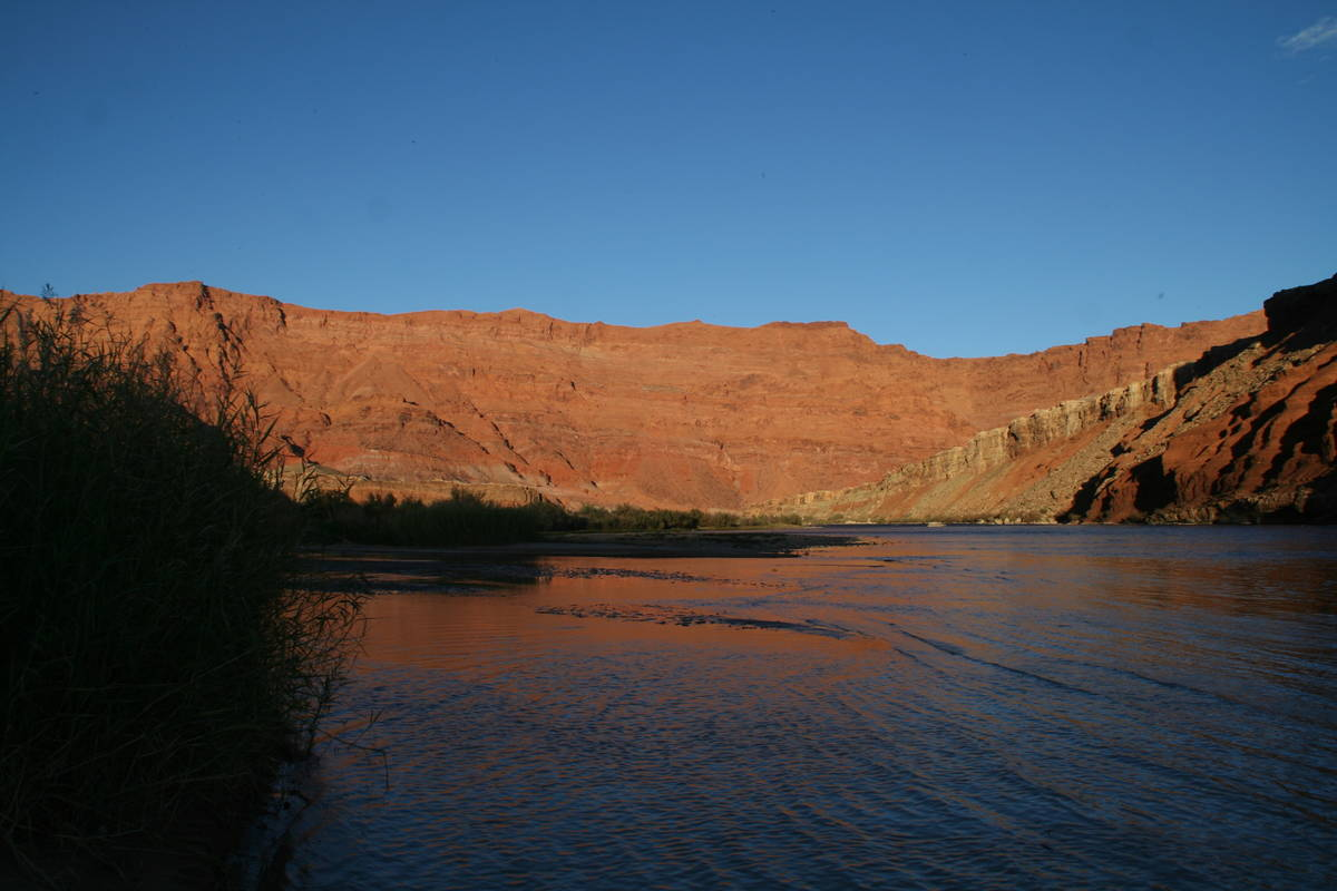 The sandstone cliffs become take on a rich glowing orange hue during sunsets at Lees Ferry. (De ...