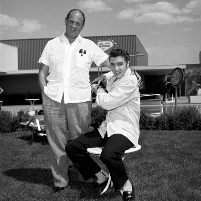 Elvis Presley takes publicity photos with his manager, Colonel Tom Parker, at the New Frontier ...