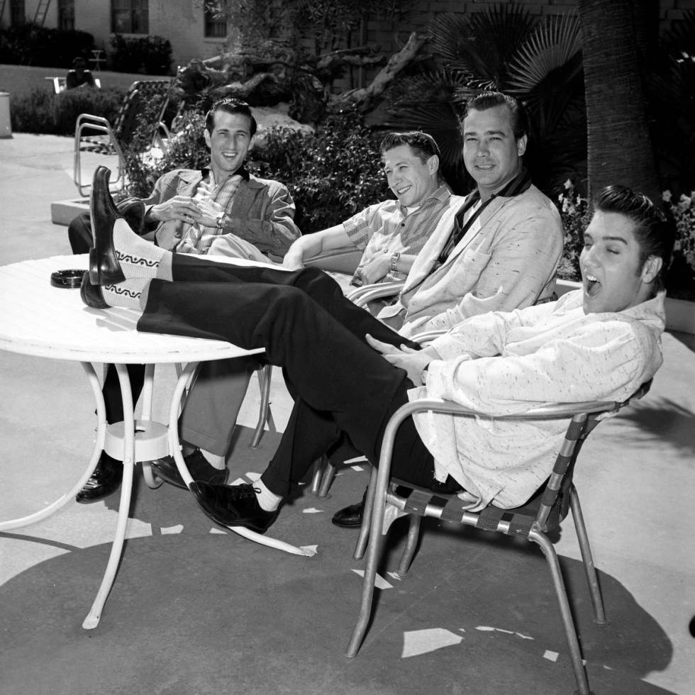 Drummer D.J. Fontana, left, guitarist Scotty Moore, bassist Bill Black and Elvis Presley relax ...