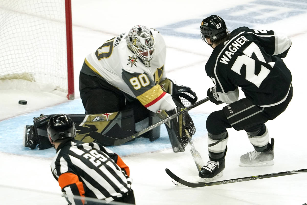 Los Angeles Kings left wing Austin Wagner, right, scores on Vegas Golden Knights goaltender Rob ...