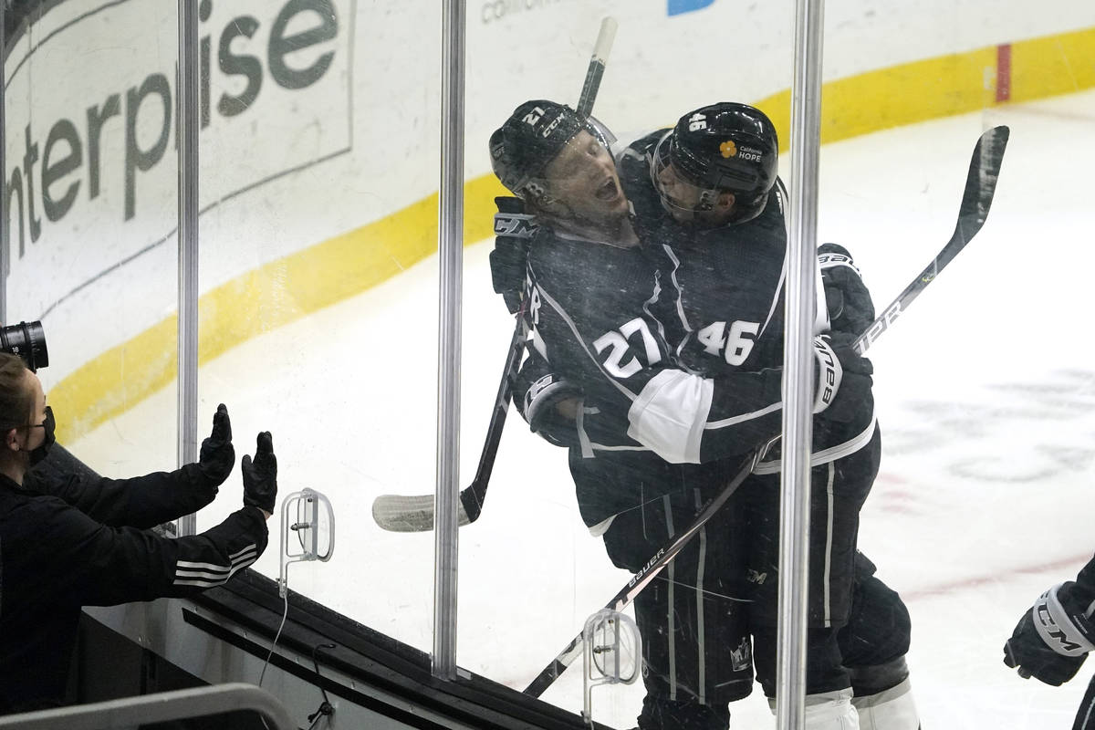 Los Angeles Kings left wing Austin Wagner, left, celebrates his goal with center Blake Lizotte ...