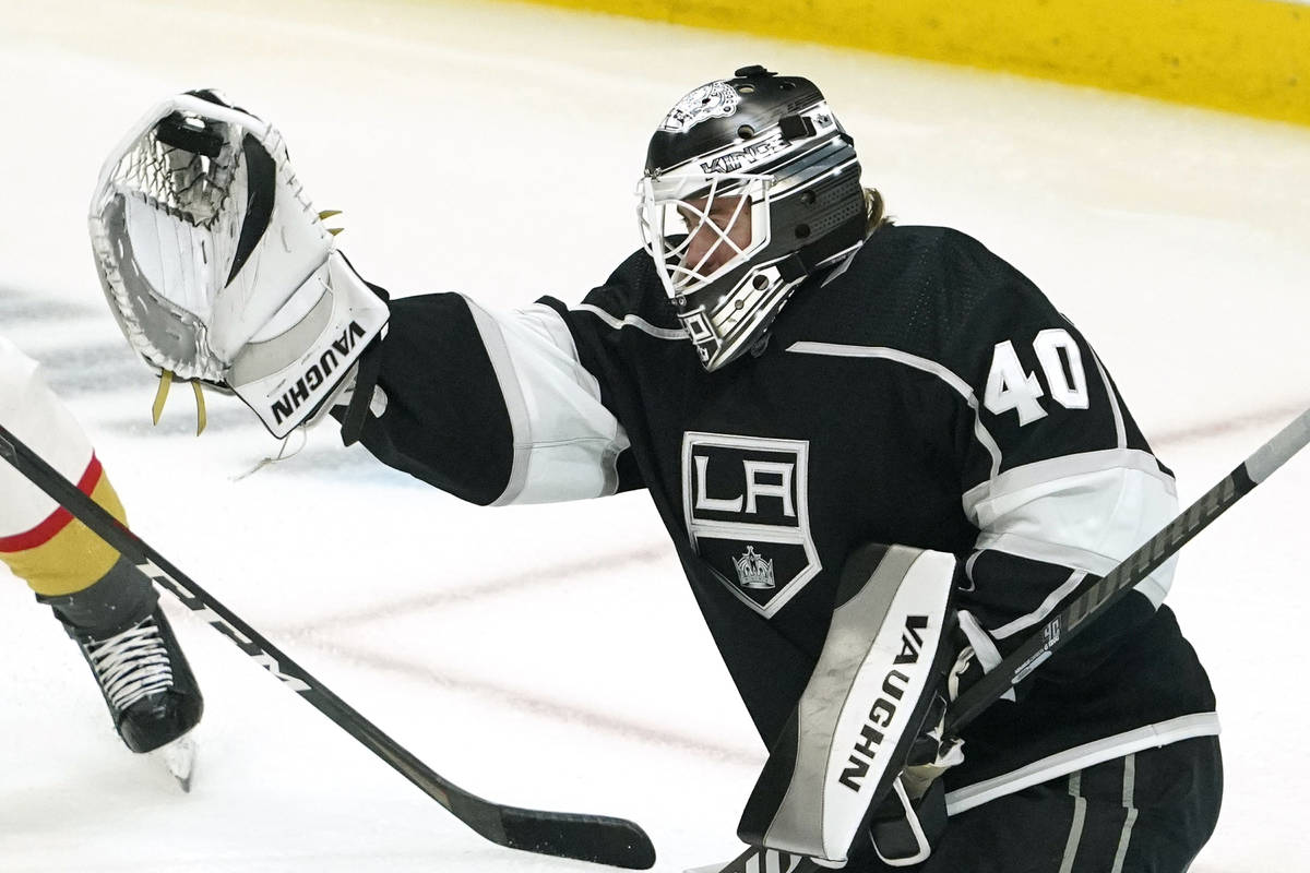 Los Angeles Kings goaltender Calvin Petersen makes a glove save during the first period of an N ...