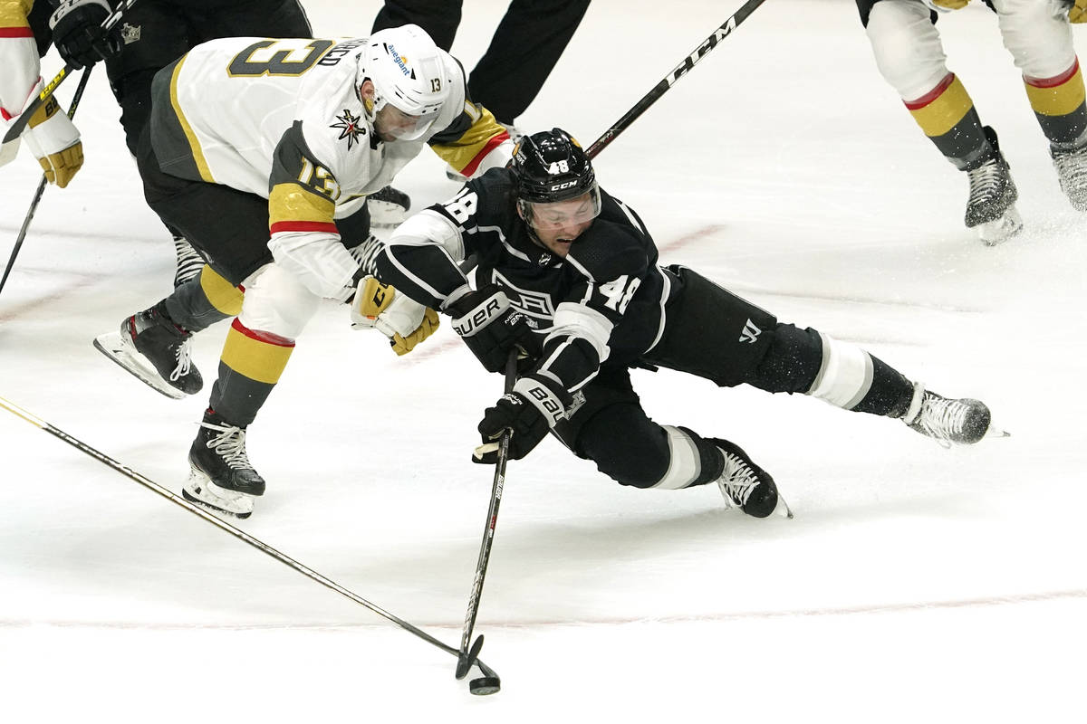 Los Angeles Kings left wing Brendan Lemieux, right, falls while under pressure from Vegas Golde ...