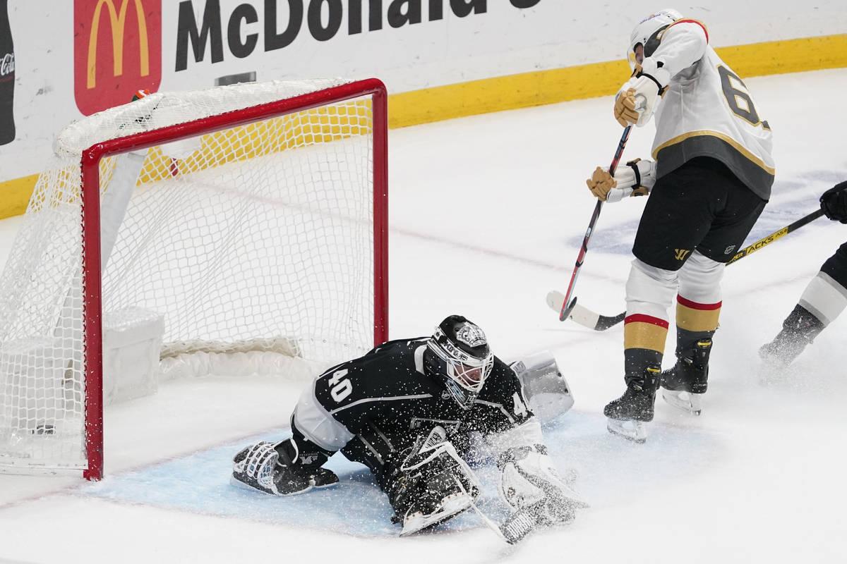 Los Angeles Kings goaltender Calvin Petersen, left, is scored on by Vegas Golden Knights right ...