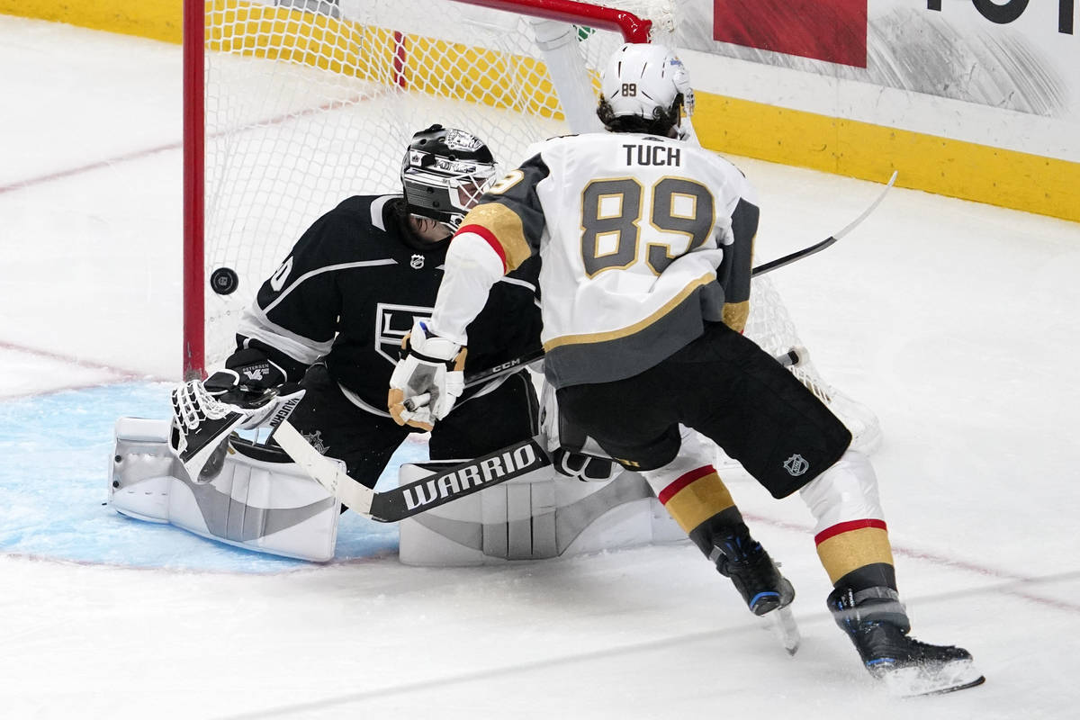 Vegas Golden Knights right wing Alex Tuch, right, scores on Los Angeles Kings goaltender Calvin ...