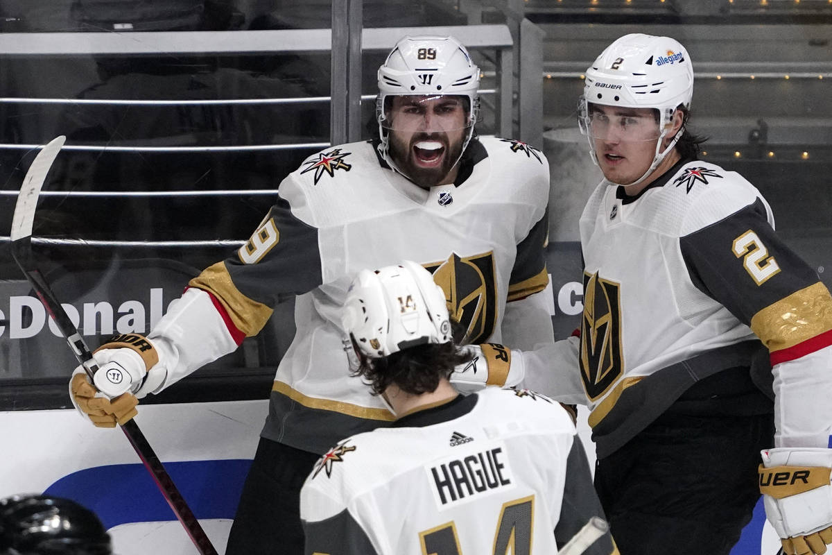 Vegas Golden Knights right wing Alex Tuch, center, celebrates his goal with defenseman Nicolas ...