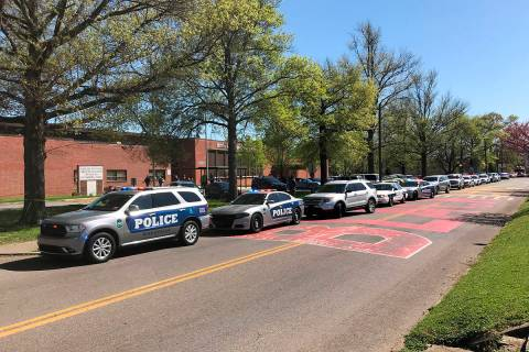 Police work in the area of Austin-East Magnet High School after a reported shooting Monday, Apr ...
