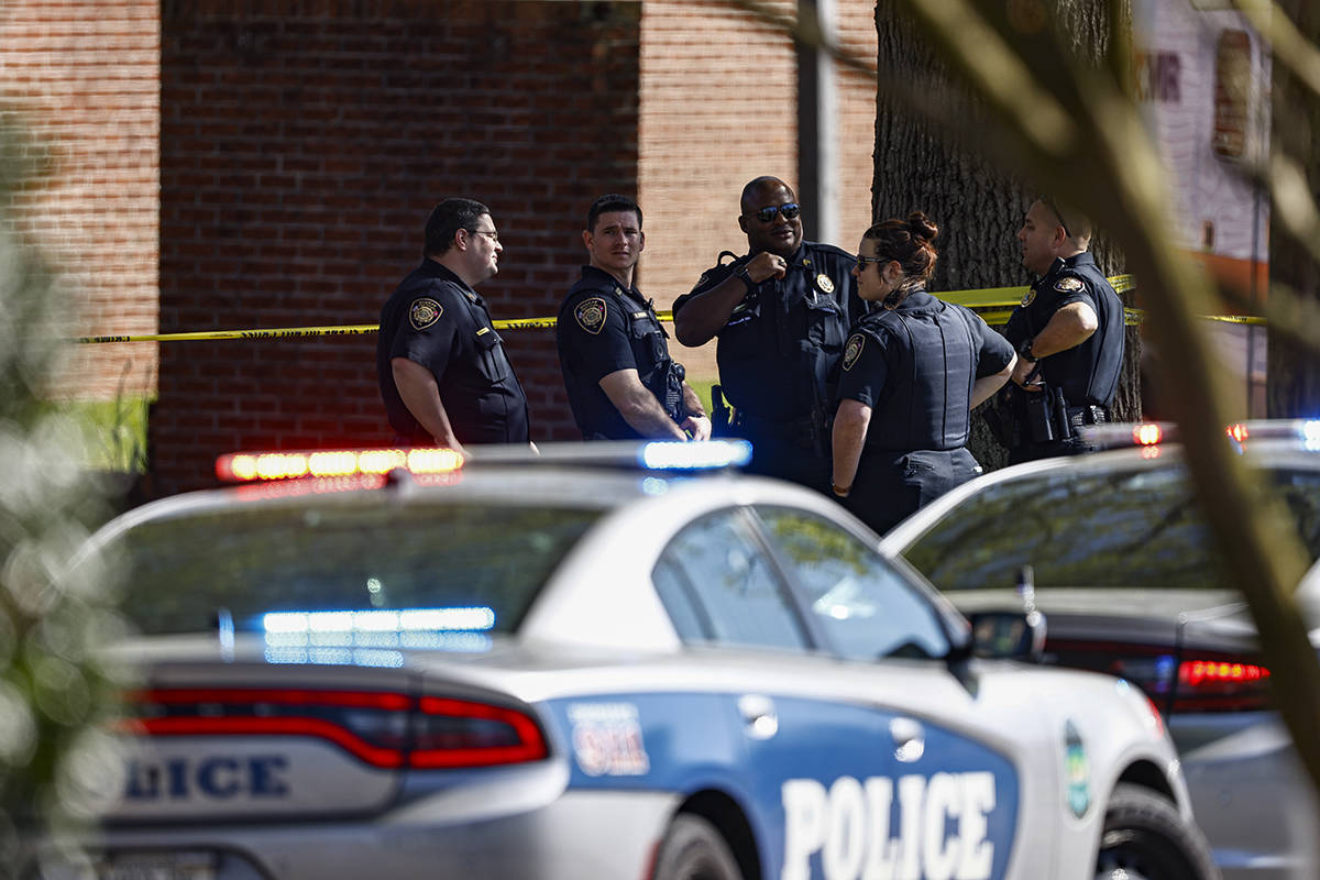 Knoxville police work the scene following a shooting at Austin-East Magnet High School in Knoxv ...