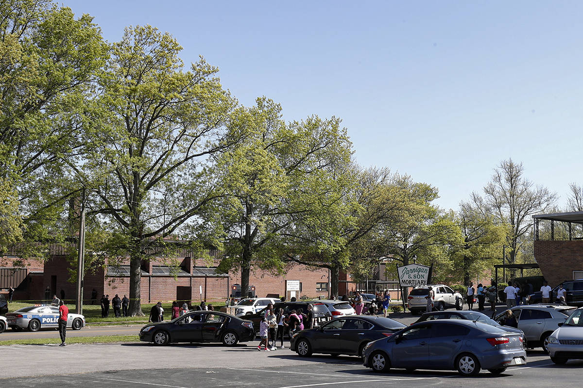 People gather outside Austin-East Magnet High School in Knoxville, Tenn., as Knoxville police w ...