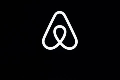 FILE - This Feb. 22, 2018, file photo shows an Airbnb logo during an event in San Francisco. (A ...