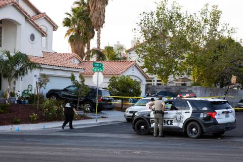 The Metropolitan Police Department investigate the fatal shooting of a young man outside a hous ...
