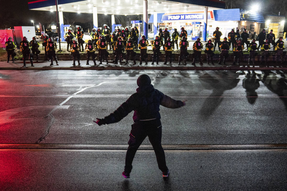 A demonstrator heckles authorities who advanced into a gas station after issuing orders for cro ...