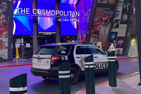 Las Vegas police units outside the Cosmopolitan Hotel on Thursday, April 8, 2021, as officers i ...
