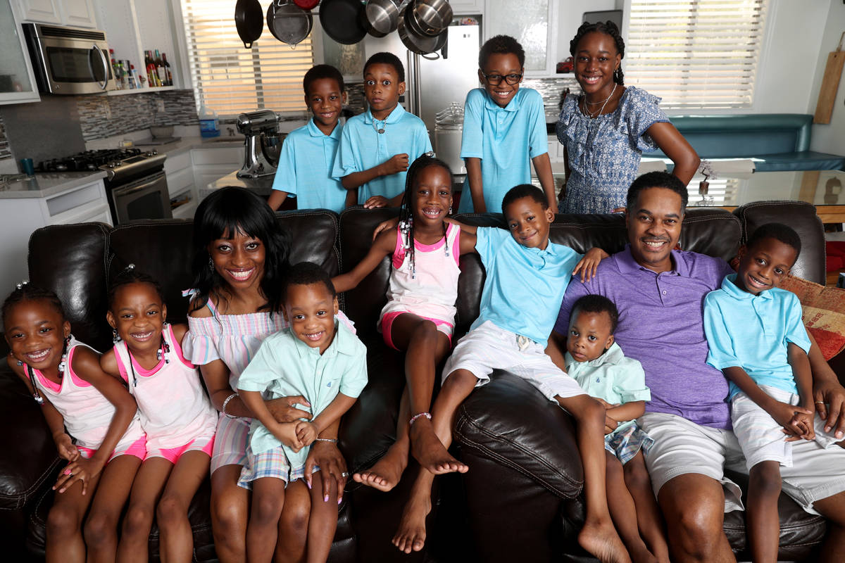 Deon and Karen Derrico with 12 of their 14 children at their North Las Vegas home Tuesday, Aug. ...