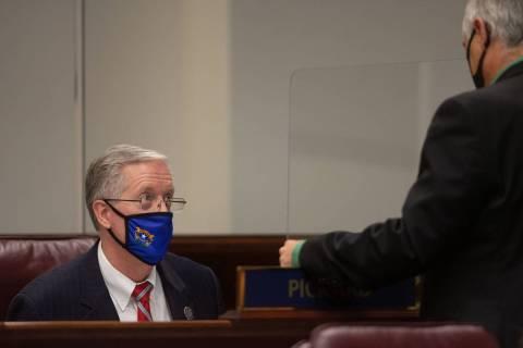 State Senator Keith Pickard speaks with Minority Leader James Settelmeyer inside the Legislatur ...