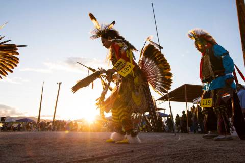 Participants dance during the grand entry ceremonies at the 29th annual Snow Mountain Pow Wow i ...