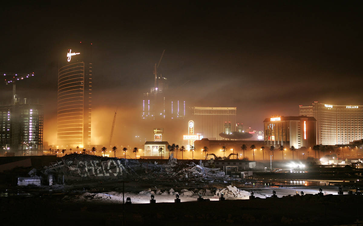 Dust hangs in the air after the Stardust was imploded early Tuesday morning, March 13, 2007, on ...