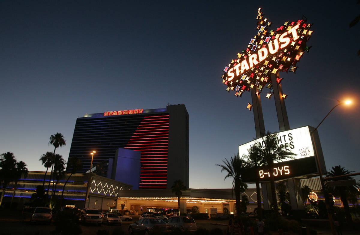 The Stardust hotel-casino glows in its signature blue and red neon as the sun sets Tuesday, Jun ...