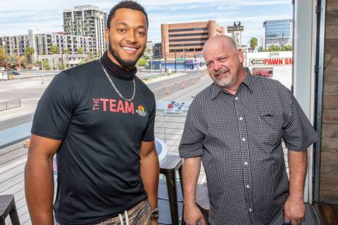 NFL quarterback Brett Hundley, left, and Las Vegas' TV reality star and pawn shop owner Rick Ha ...