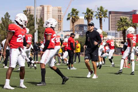 UNLV men's football head coach Marcus Arroyo watches his players during teamÕs practice on ...