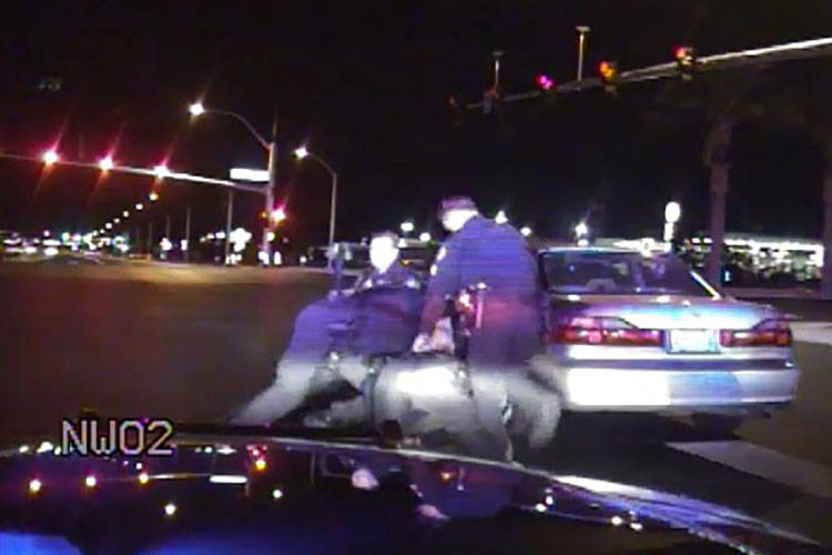 Brett Seekatz is seen in this video, along with Nevada Highway Patrol troopers and Henderson po ...